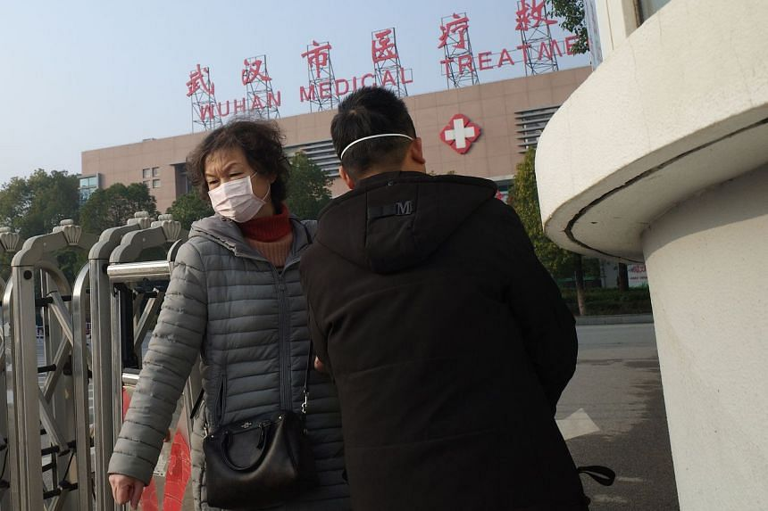 People outside the Wuhan Medical Treatment Centre in Hubei province, China, on Jan 12, 2020. A 69-year-old man has died from a mystery virus that left dozens of people ill in Wuhan.