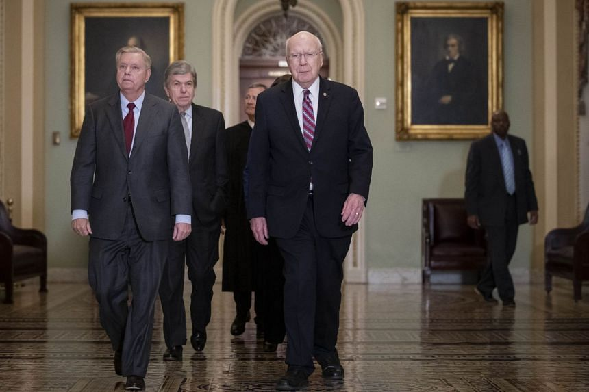 (Left to right) Sen. Lindsey Graham, Sen. Roy Blunt, Supreme Court Chief Justice John Roberts and Sen. Pat Leahy arrive to the Senate chamber for impeachment proceedings in Washington on Jan 16, 2020.