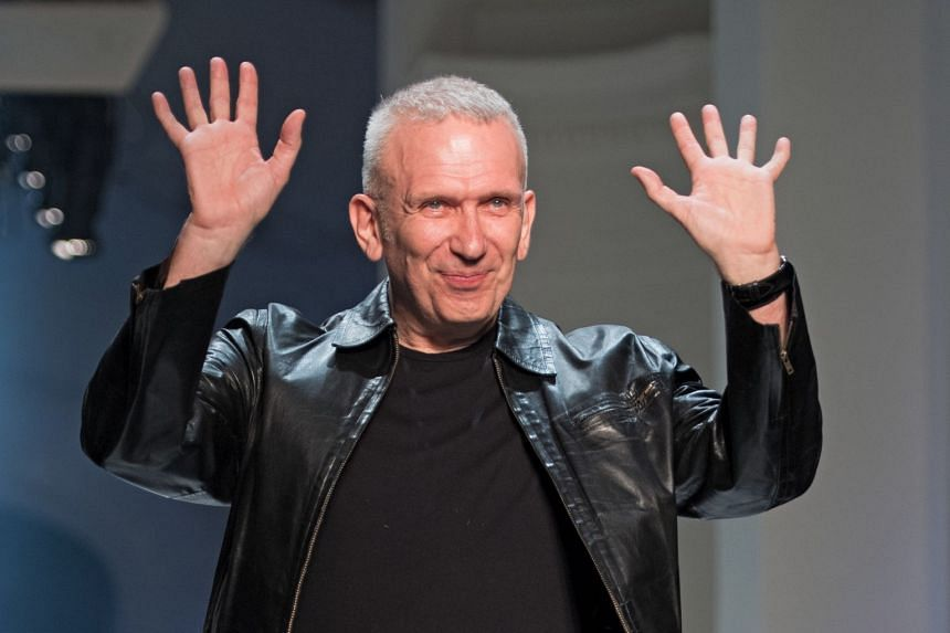 Gaultier takes to the catwalk to thank the audience during Paris Fashion Week, in July 2018.