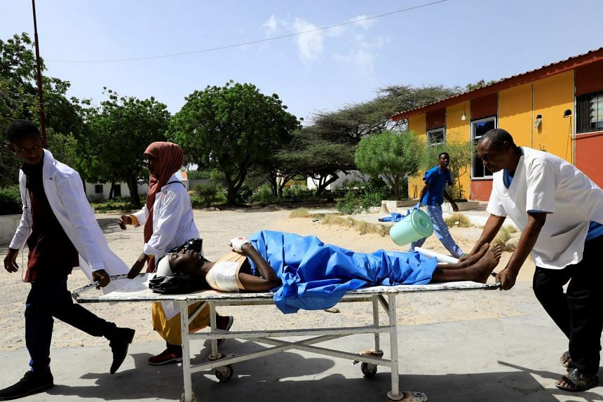 Paramedics assist a man injured in the explosion in Afgoye.