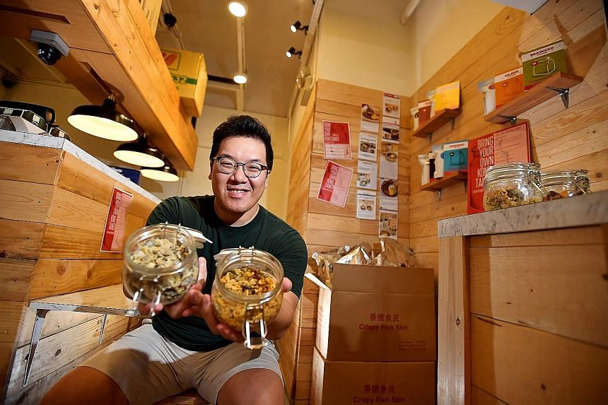 Mr Ken Tan, founder of DOCO by Fish Sh-nack which sells fish-skin snacks at International Plaza, jumped on the bringyour- own-container bandwagon this year. Customers with their own jars get a discount.