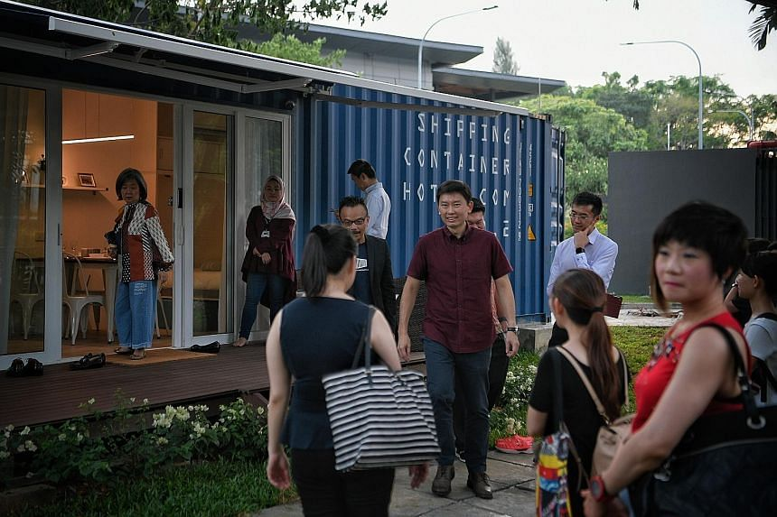 Senior Minister of State for Trade and Industry Chee Hong Tat visiting one of two container hotel units at the JTC One-North @ Launchpad yesterday.