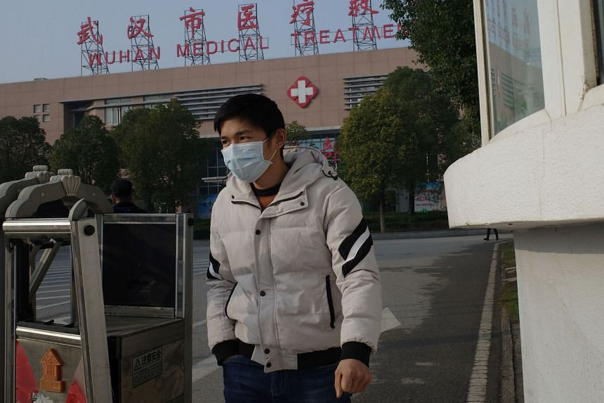 A man leaves the Wuhan Medical Treatment Centre, where a man who died from a respiratory illness was confined, in the city of Wuhan, China.