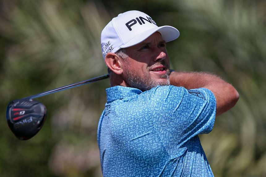 Lee Westwood of England plays a shot on the third day of the Abu Dhabi HSBC Golf Championship.