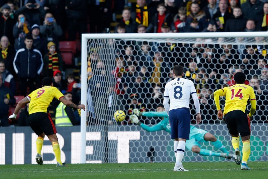 Tottenham Hotspur's Paulo Gazzaniga saves a penalty from Watford's Troy Deeney during their English Premier League at Vicarage Road Stadium on Jan 18, 2020.
