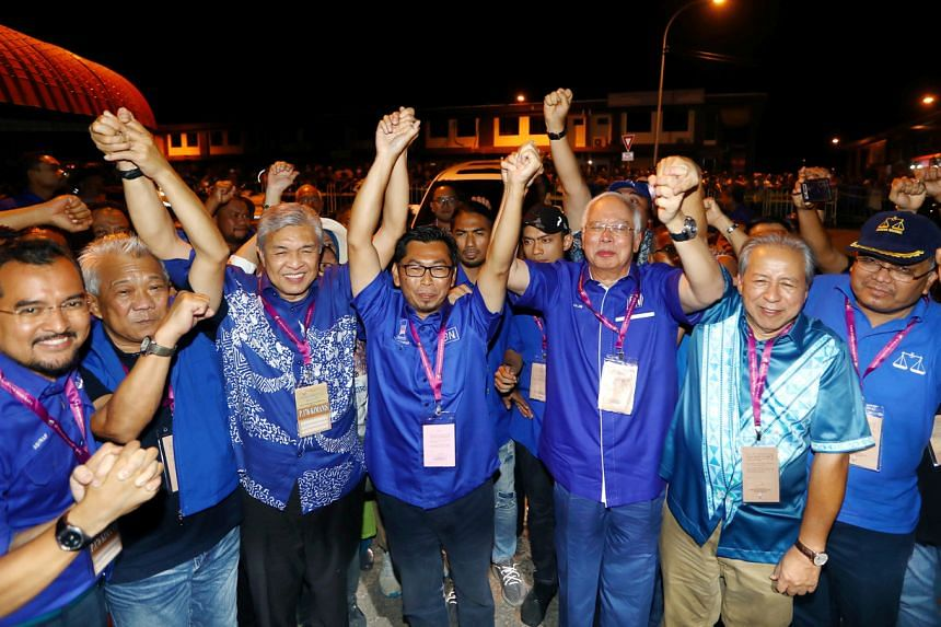 Umno candidate Mohamad Alamin (centre), flanked by former Malaysian premier Najib Razak and Umno president Ahmad Zahid Hamidi, after his victory in the by-election in Kimanis, Sabah.