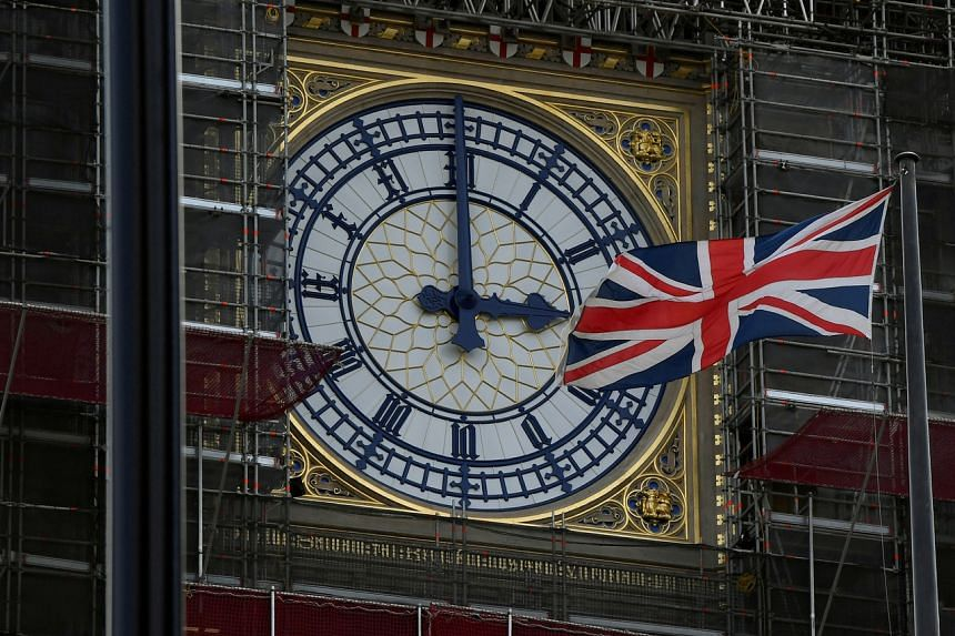 British Union Jack Flies in front of the clock face of the tower that houses the Big Ben bell in London on Aug 29, 2019.