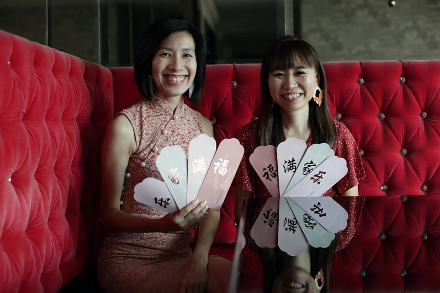 Michelle Tay's (right) and Serene Wu's ang pows are part of their business called Love Bond.