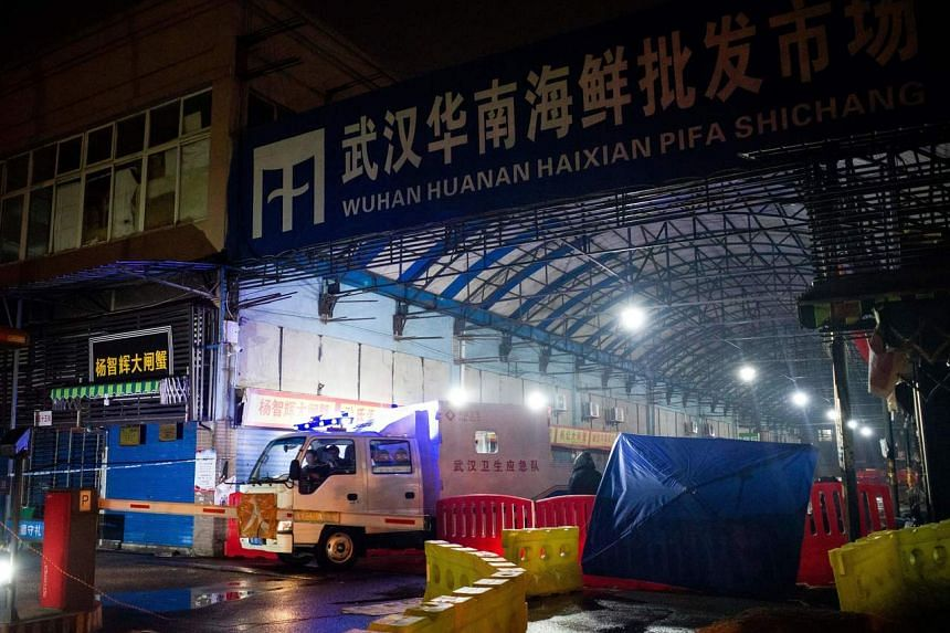 Officials leaving the closed Huanan Seafood Wholesale Market, on Jan 11, 2020.