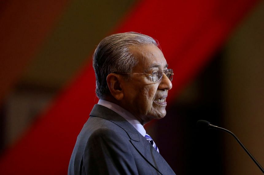 """Malaysia's Prime Minister Mahathir Mohamad, who has temporarily taken over the Education Ministry portfolio, said students """"can wear brown shoes, black shoes, grey shoes, white shoes - any shoes will do""""."""