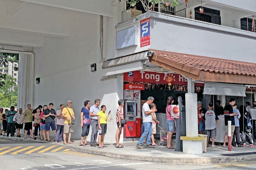 Punters queuing for the $9.9 million Reunion Draw at Block 685 Hougang Street 61, on Jan 15, 2020.