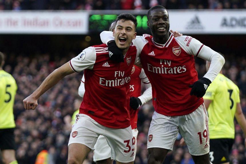 Arsenal's Gabriel Martinelli (left) celebrates after scoring.