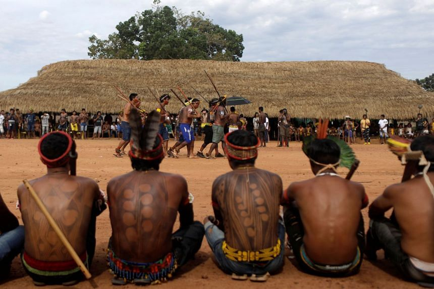 Indigenous people perform during a four-day pow wow in Piaracu village, in Xingu Indigenous Park.