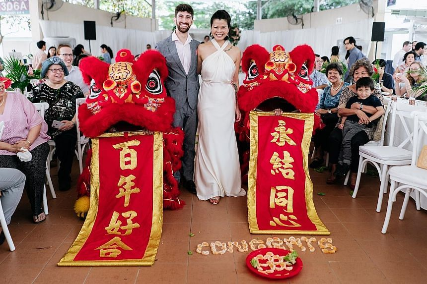Some 150 guests, including friends and family from England, Ireland, Slovakia, Switzerland, Chicago and Los Angeles, attended the couple's Jewish-style wedding with a lion dance at a covered linkway in Clementi Avenue 4. Food from their favourite Ind