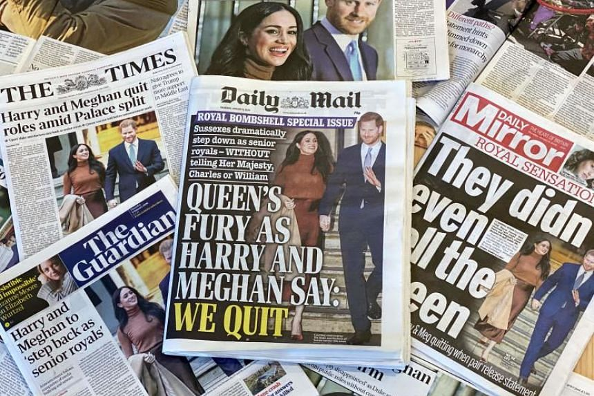 """A photo taken on Jan 9, 2020, shows an arrangement of British daily newspapers with front page headlines reporting on the news that Prince Harry and his wife Meghan, plan to step back as """"senior"""" members of the Royal Family."""
