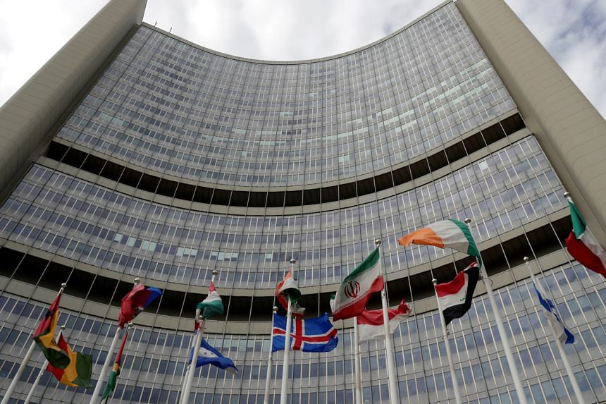 An Iranian flag flutters among other flags in front of the International Atomic Energy Agency headquarters in Vienna on Sept 9, 2019.