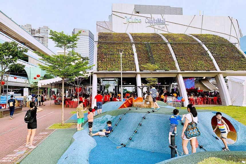 The playground and green roof pavilion at J Link pedestrian mall, which is a popular gathering spot for the community.