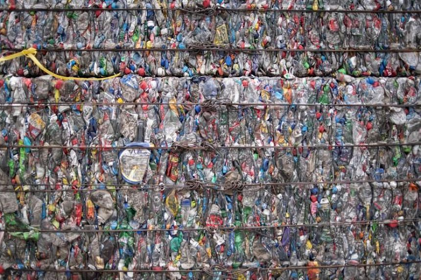 A block of compressed plastic bottles are seem at a plastic waste centre in the outskirts of Beijing on May 16, 2019.