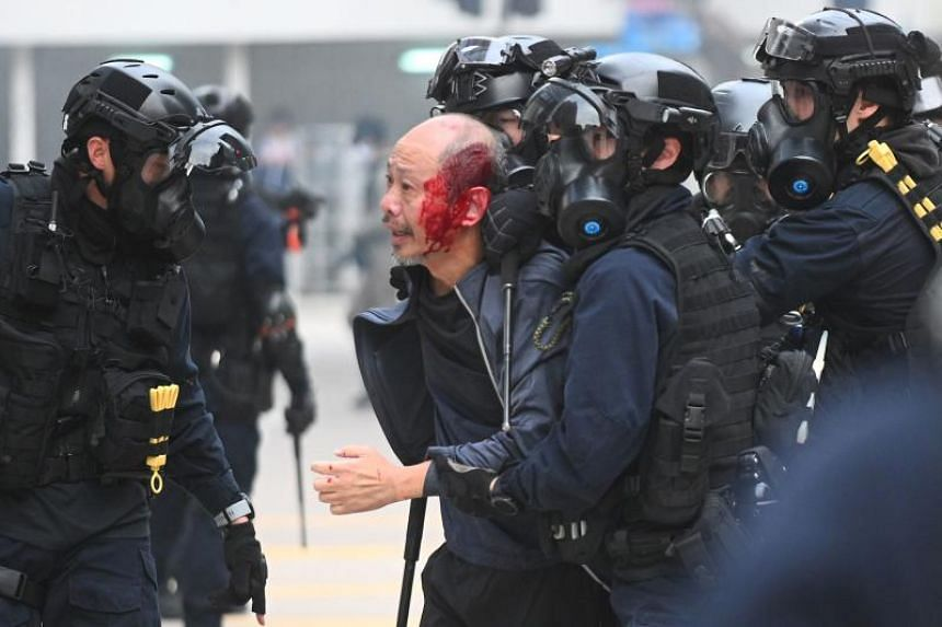 Police detain an injured man after dispersing a rally in Chater Garden in Hong Kong on Jan 19, 2020.