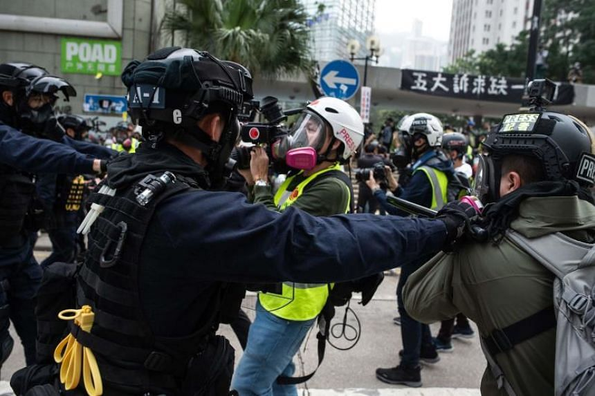 Police clash with journalists after dispersing a rally at Chater Garden in Hong Kong on Jan 19, 2020.