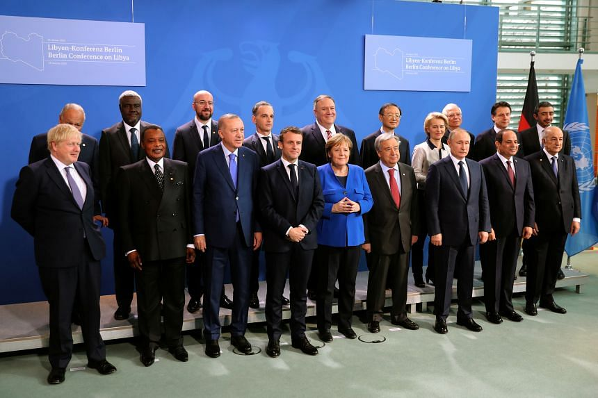 Global leaders pose for a group photo during the Libya summit in Berlin, on Jan 19, 2020.