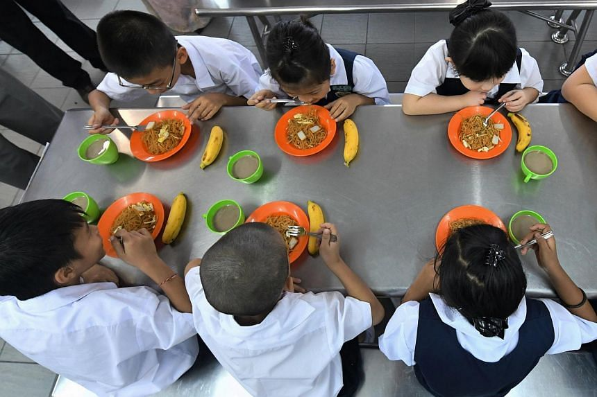 Pupils of Salak South Chinese primary school, in Selangor, enjoying a meal as part of the food supplementary programme launched on Jan 20 by the Malaysian government.