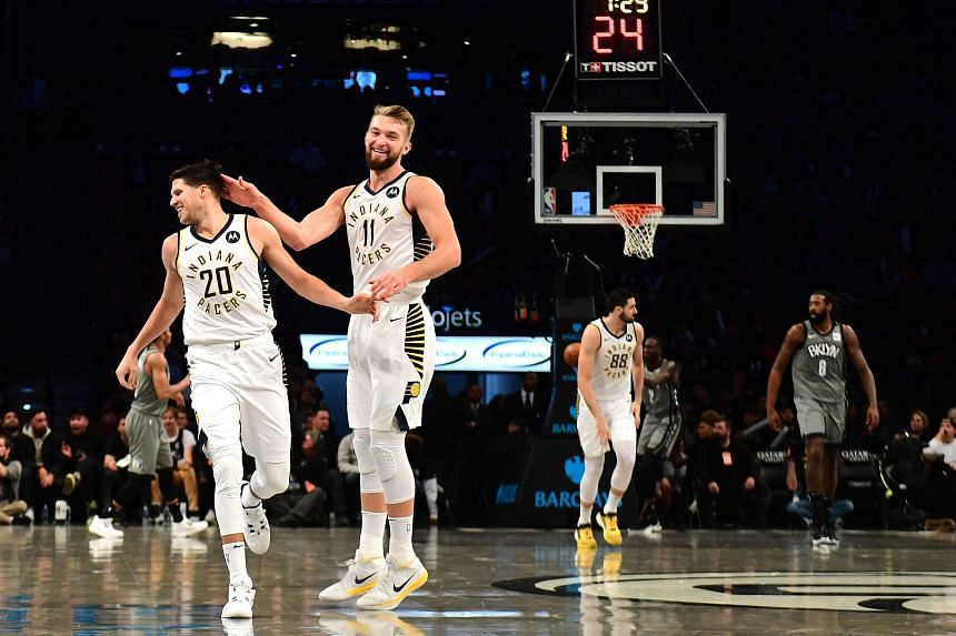 In a photo from Nov 18, 2019, Doug McDermott (left) and Domantas Sabonis of the Indiana Pacers react against the Brooklyn Nets at Barclays Center in Brooklyn, New York.