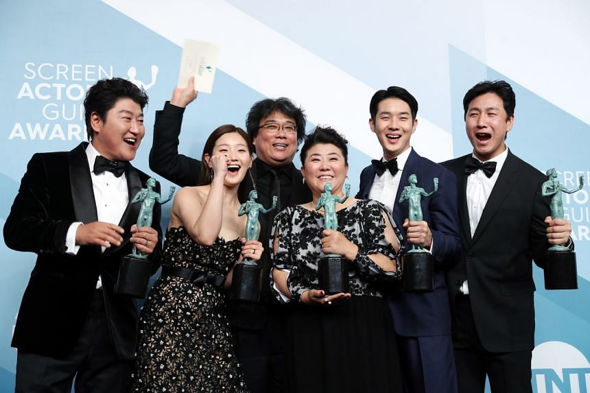 Director Bong Joon-ho (centre) and the cast of Parasite with their awards during the Screen Actors Guild Awards ceremony at the Shrine Auditorium in Los Angeles on Jan 19, 2020.