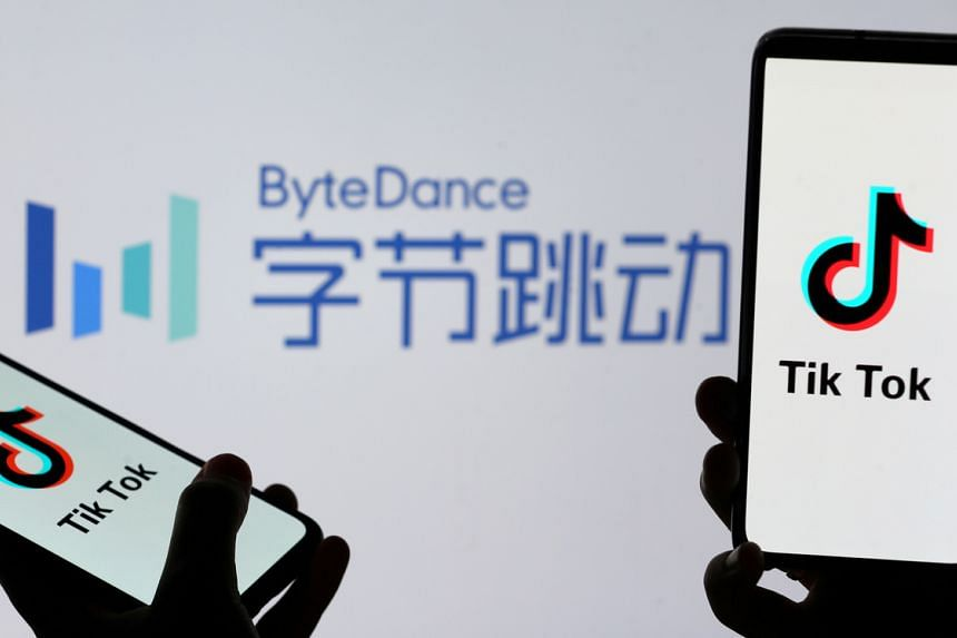 Tik Tok logos are seen on smartphones in front of a displayed ByteDance logo on Nov 27, 2019.