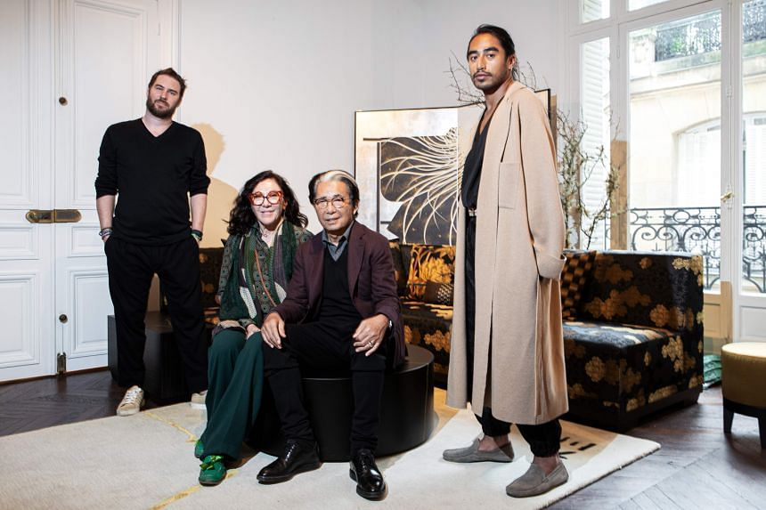 Kenzo, flanked by his assistants (from left) Jonathan Bouchet Manheim, Wanda Jelmini and Engelbert Honorat, launched K3, an interior design brand whose logo is written in Japanese with three horizontal strokes.