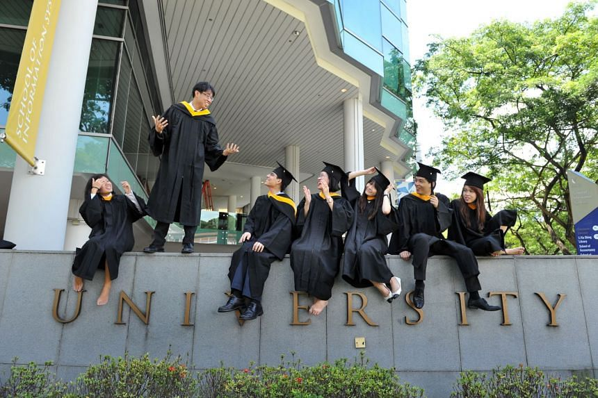 Singapore Management University students in convocation gowns on July 21, 2012.