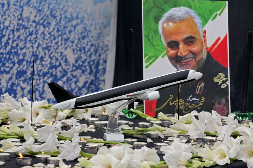 A poster of slain military commander Qasem Soleimani is seen at a memorial for the victims of a Ukrainian plane crash in the University of Teheran, on Jan 14, 2020.