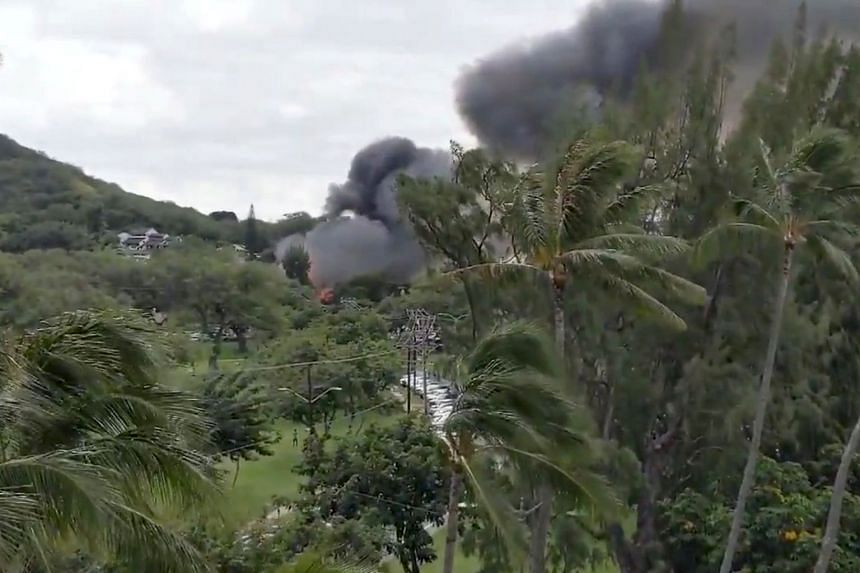 Smoke billowing from a fire at Kapiolani Park where a shooting incident occurred before a house was set on fire, in Honolulu, Hawaii, on Jan 19, 2020.