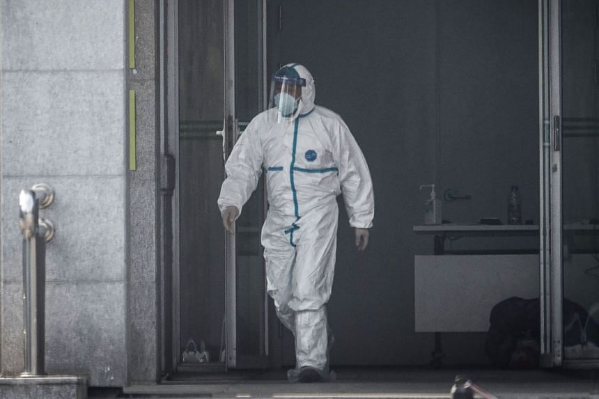 A medical staff member walks outside the Jinyintan hospital, where patients infected by a mysterious Sars-like virus are being treated, in Wuhan on Jan 18, 2020.