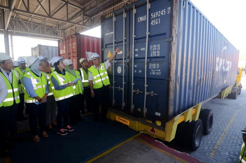 Malaysia's Energy, Science, Technology, Environment and Climate Change Minister Yeo Bee Yin (front row, third from left) inspects a container filled with plastic waste that will be sent back to its country of origin at Penang Port on Jan 20, 2020.