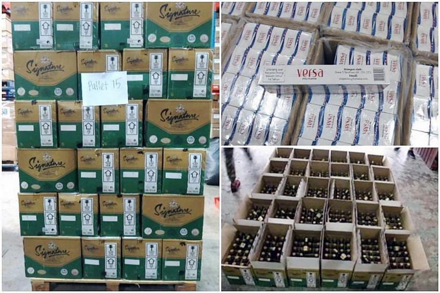 A total of 16,435 cartons and 11 packets of cigarettes, and 22,094 bottles of liquors were seized from a warehouse at Airport Logistics Park Singapore, on June 9, 2016.