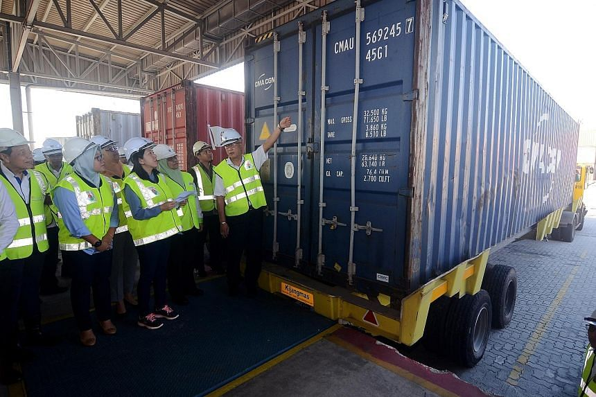 Malaysia's Energy, Science, Technology, Environment and Climate Change Minister Yeo Bee Yin (centre) at Penang Port yesterday, inspecting a container filled with plastic waste that will be returned to its country of origin.