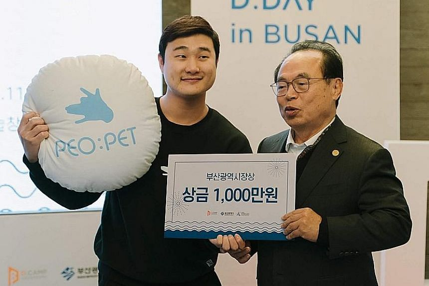 Representatives of three Singapore start-ups - (from left) Ematic Solutions chief financial officer Simon Wong, Zeemart chief product officer Keith Tan and Fooyo co-founder Li Shaohuan - at the Asean-ROK Start-up Expo in Busan last November. The upco