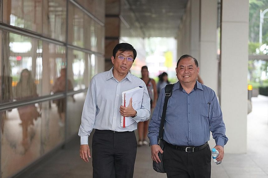 SDP secretary-general Chee Soon Juan (left) and vice-chairman John Tan (right) leaving the Supreme Court on Thursday.