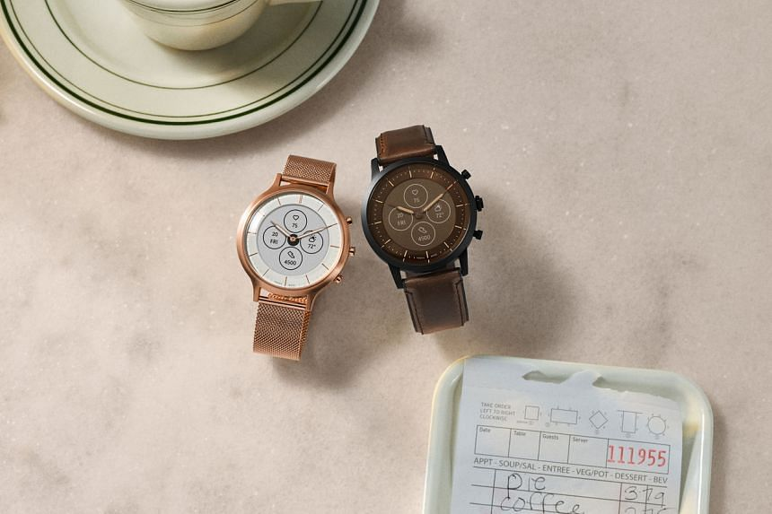 The Fossil Hybrid HR Charter (left) and Collider smartwatch.