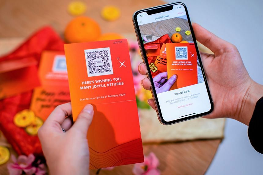 A customer scanning the DBS QR Gift to give away as an e-hongbao.