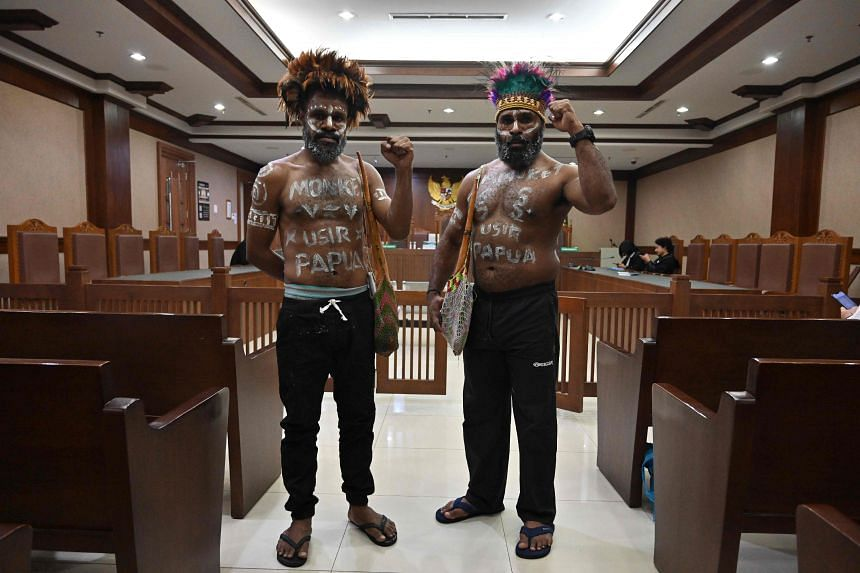 Papuan activists Ambrosius Mulait and Dano Anes Tabuni are seen prior to a court hearing in Jakarta on Jan 20, 2020.