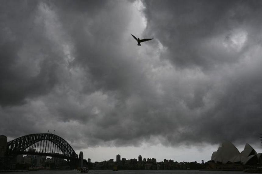 Storm clouds gather over Sydney Harbour, on Jan 20, 2020.