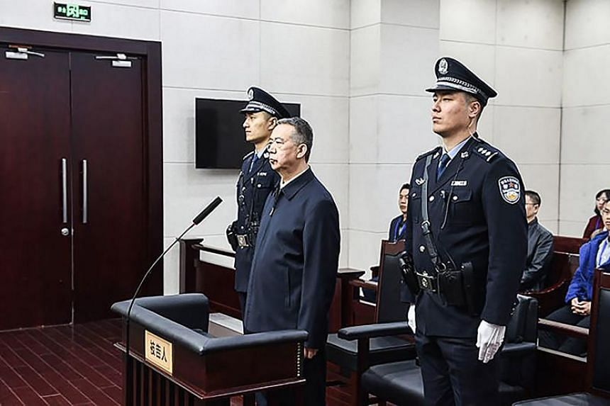 Former Interpol chief Meng Hongwei (centre) is seen during his sentencing at the court in Tianjin on Jan 21, 2020.