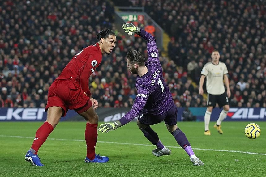 Goalkeeper David de Gea falling after a clash with Liverpool's Virgil van Dijk in Sunday's Premier League game. Referee Craig Pawson did not give a foul and Manchester United's players confronted him to protest after Roberto Firmino scored in the aft