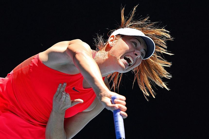 Maria Sharapova (far left) showed flashes of her old form in her 6-3, 6-4 loss to 19th seed Donna Vekic at the Rod Laver Arena. PHOTO: EPA-EFE