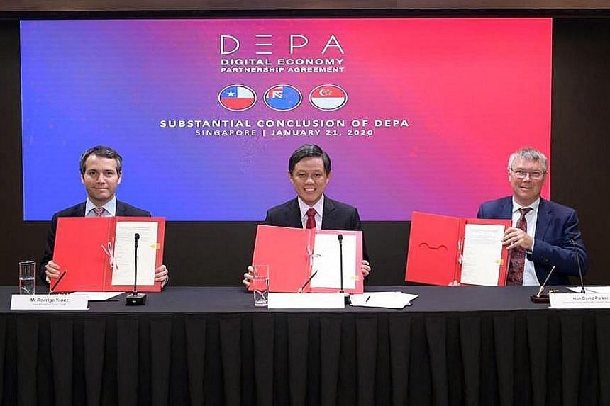 From left: Chile's Vice-Minister for Trade Rodrigo Yanez; Trade and Industry Minister Chan Chun Sing; and New Zealand's Minister for Trade and Export Growth David Parker after signing a joint statement on the substantial conclusion of talks on the Di
