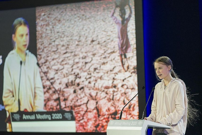 Swedish climate activist Greta Thunberg addressing a panel session at the opening of the World Economic Forum in Davos yesterday.