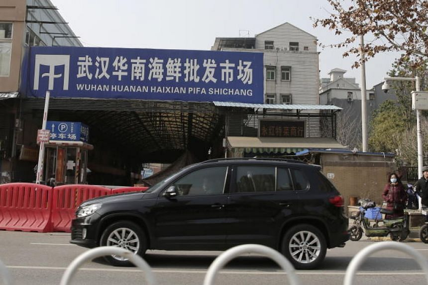The Huanan Seafood Market came under greater scrutiny as Chinese officials said that the virus which has so far killed nine people and infected hundreds may have originated in a wild animal sold at the food emporium.