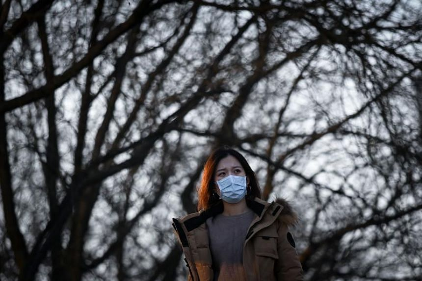 A woman wearing a protective mask in Beijing, on Jan 22, 2020. More people than usual were seen wearing masks on the streets and several stores run out of stock.